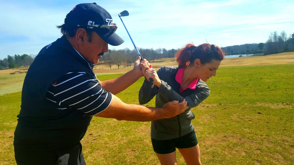 Golf instructor gives golf lesson